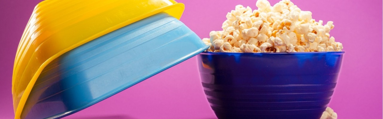 """alt=""""small colored bowls set with one filled with popcorn"""""""